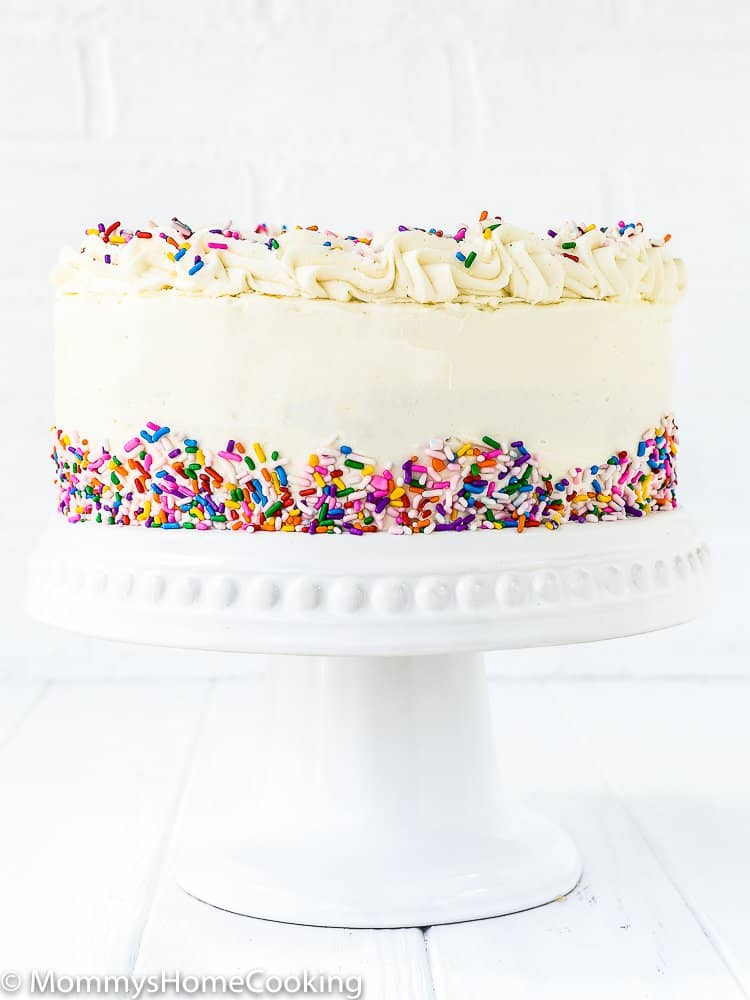 This Eggless Vanilla Cake Recipe is the bomb!! Its sweet buttery flavor and light and moist texture make it perfect to celebrate any occasion! http://mommyshomecooking.com
