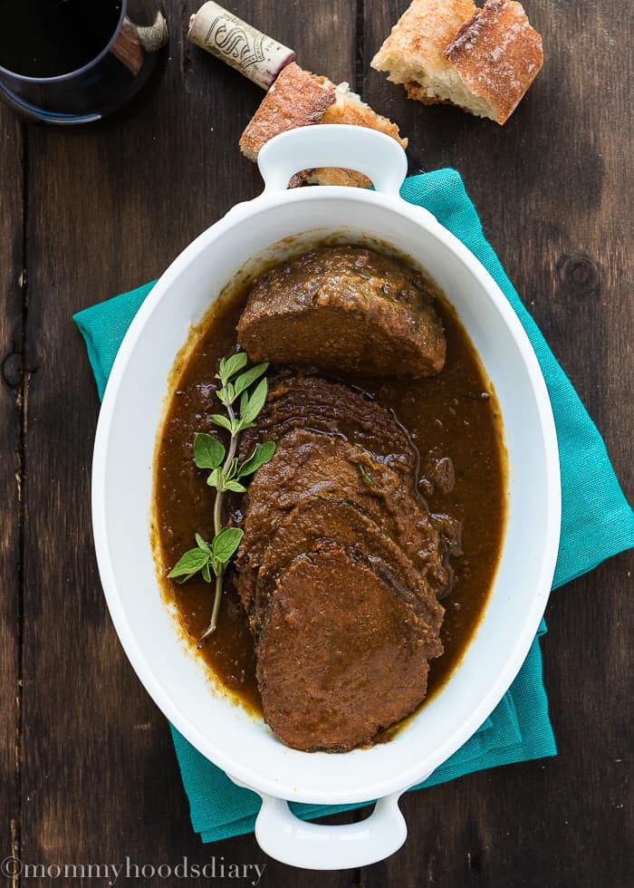 Venezuelan Asado Negro - Perfect Eye of Round Roast cooked in a flavorful wine broth until the beef is meltingly tender and divine. http://mommyshomecooking.com