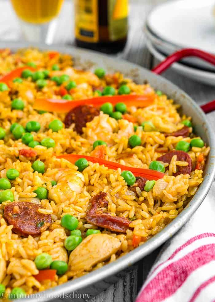This Quick and Easy Paella recipe is easy enough for a weeknight meal, yet fancy enough to serve to dinner guests. It's studded with chorizo, chicken and shrimp. Full of Spanish flair and amazingly tasty! https://mommyshomecooking.com