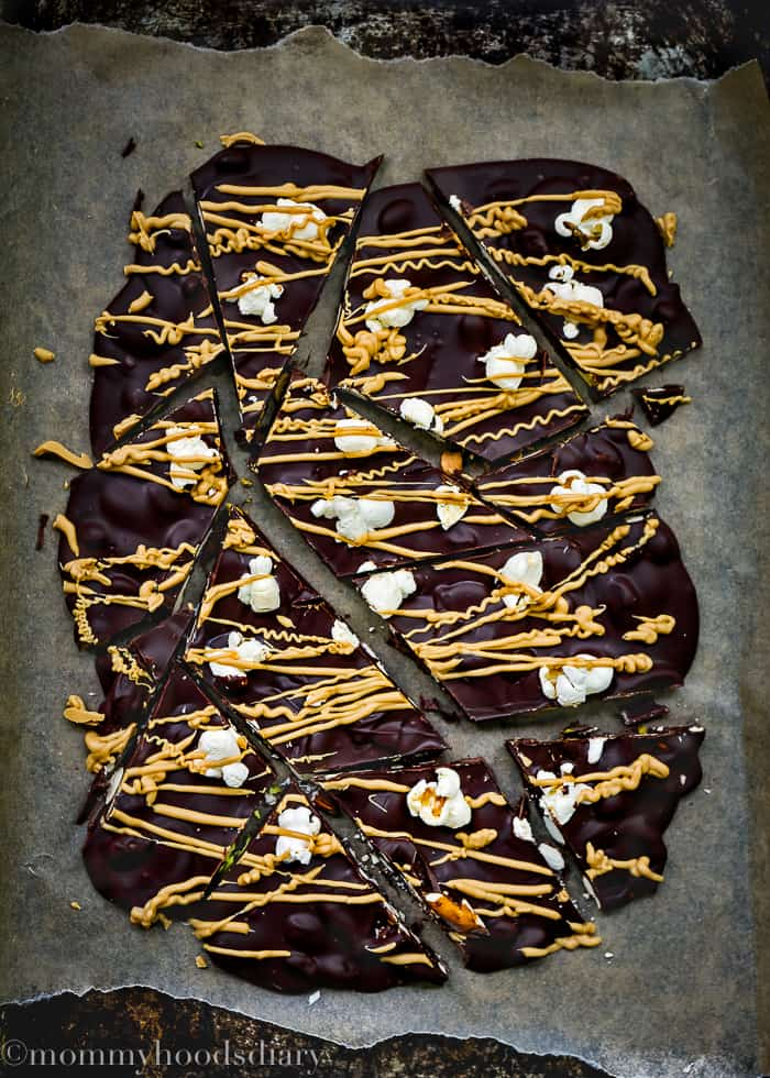 Who can resist this Dulce de Leche Chocolate Bark? Velvety chocolate with nuts, pretzels, and topped with popcorn and dulce de leche chocolate. An award-worthy snack!! https://mommyshomecooking.com
