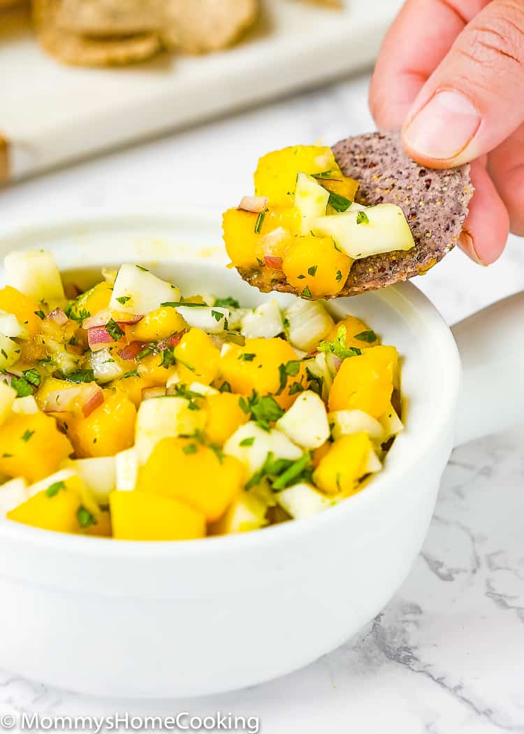 This Fennel Mango Salsa is a crowd pleaser, colorful and full of big flavors! Serve with chips, on tacos or tostadas, or on grilled fish, pork or chicken. http://mommyshomecooking.com