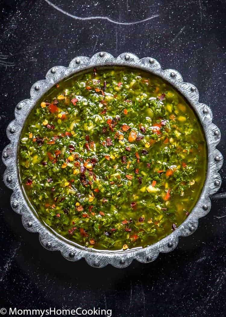 This Easy Chimichurri will deliver big flavor to anything you're grilling! It's garlicky, herby, tangy, slightly spicy and incredibly versatile since it can be used both, as a marinade and a sauce. http://mommyshomecooking.com