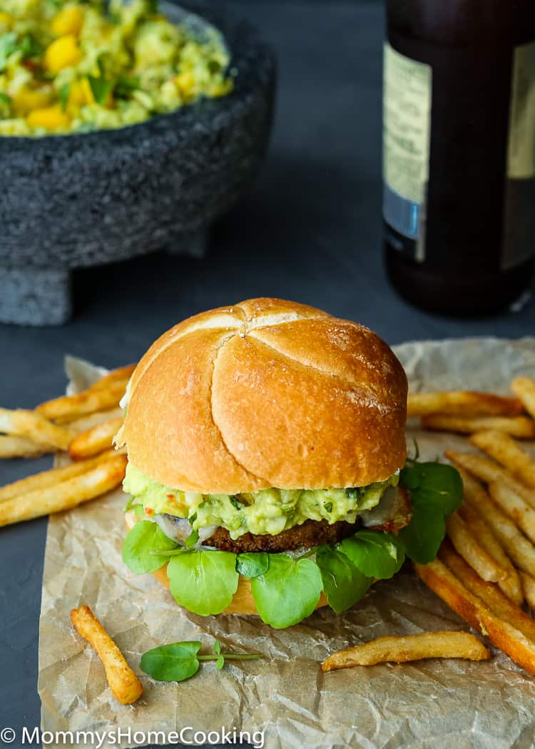 This Mango Guacamole Turkey Burger is a juicy goodnessparty for your taste buds! It's tasty, smoky, and slathered in THE BEST mango guacamole ever. The perfect, delicious and healthier time-saving alternative to your barbecue spread. http://mommyshomecooking.com