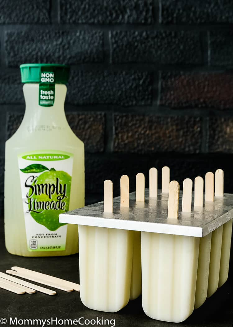 These Easy Key Lime Popsicles are refreshing, sweet and slightly tangy, and have a perfect balance of flavors. Made with only three ingredients, these frosty treats will keep you cool and your kids happy all summer long. http://mommyshomecooking.com