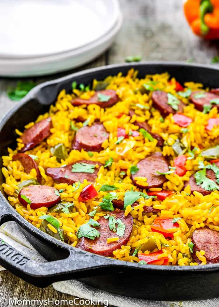 This Easy Sausage and Peppers Rice Skillet is really satisfying and delicious. it's easy and quick to put together since it's done in 30 minutes. Perfect for any day of the week! http://mommyshomecooking.com