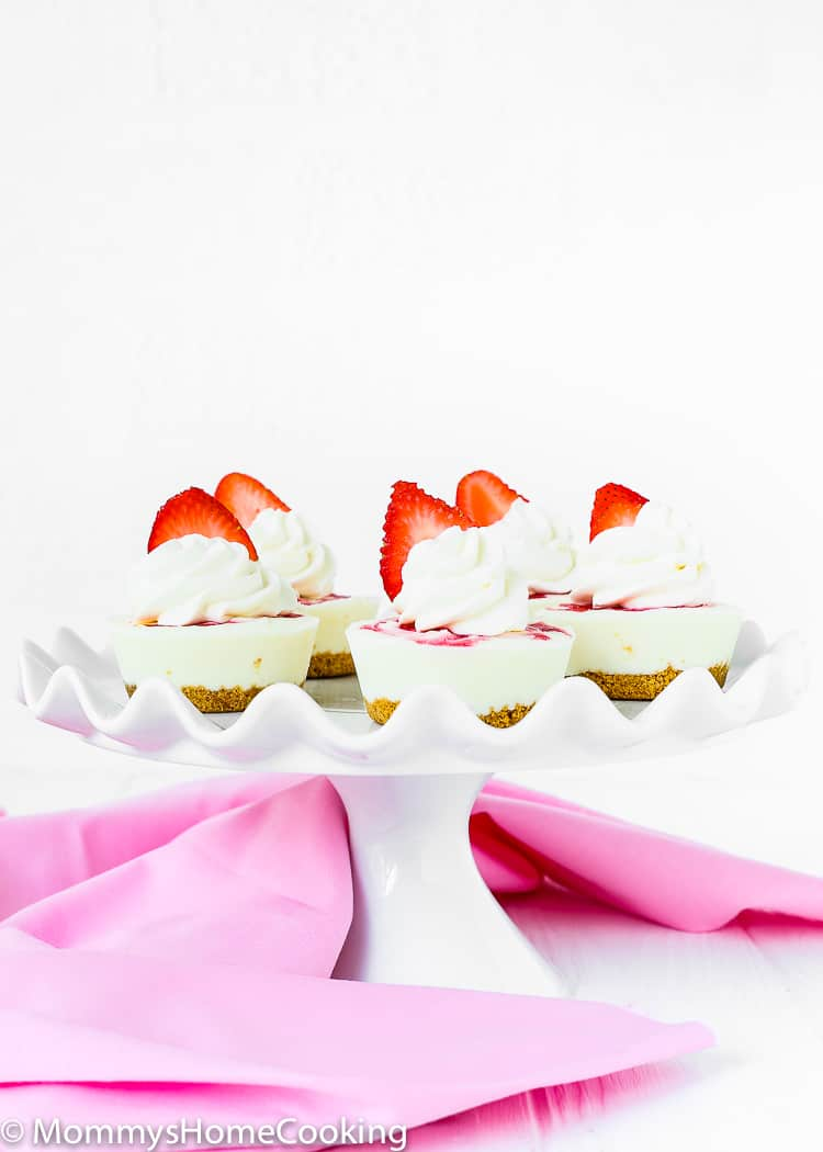 These light and bright Mini Greek Yogurt Strawberry cheesecake are perfect for when it's too hot to turn on the oven. Made with Greek yogurt, these little treats are easy to make and will definitely be a crowd pleaser. http://mommyshomecooking.com