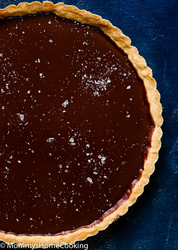 This Easy Eggless Chocolate Tart is a ridiculously easy and scrumptious dessert! The flavors of the rich chocolate filling and the buttery flaky crust meld together like no other. You have to taste it for yourself. http://mommyshomecooking.com