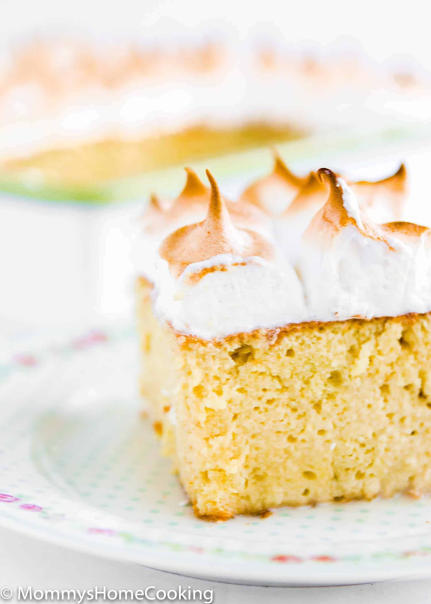 This Tres Leches Cake is amazingly delicious! An ultra luscious cake soaked in a sweet milk mixture and topped with Italian meringue. https://mommyshomecooking.com