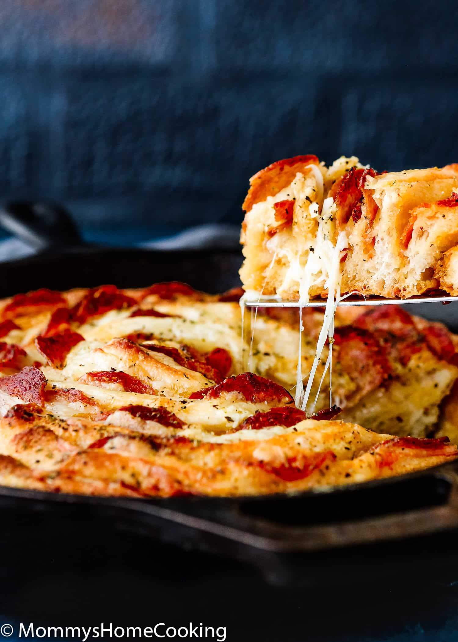 This Swiss Cheese and Pepperoni Spiral is ultra-easy to make and perfect for game days and all gatherings. It's cheesy and irresistibly delicious! A touchdown-worthy appetizer. https://mommyshomecooking.com