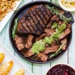 GRILLED BALSAMIC-GARLIC STEAK on a cast iron skillet with cilantro mojo