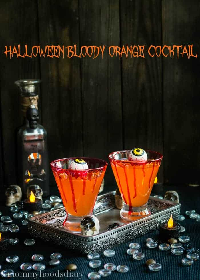 Halloween never tasted better…This Halloween Bloody Orange Cocktail is so easy to make and your guests will freak out over the flavor! https://mommyshomecooking.com