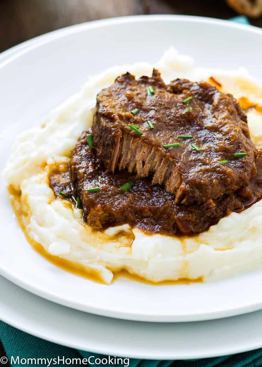 Asado Negro in a white plate with mashed potatoes  and sauce