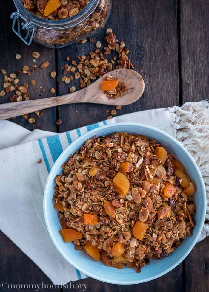 This Coconut Apricot Granola recipe is so easy to make and so delicious that you'll never buy granola again. https://mommyshomecooking.com
