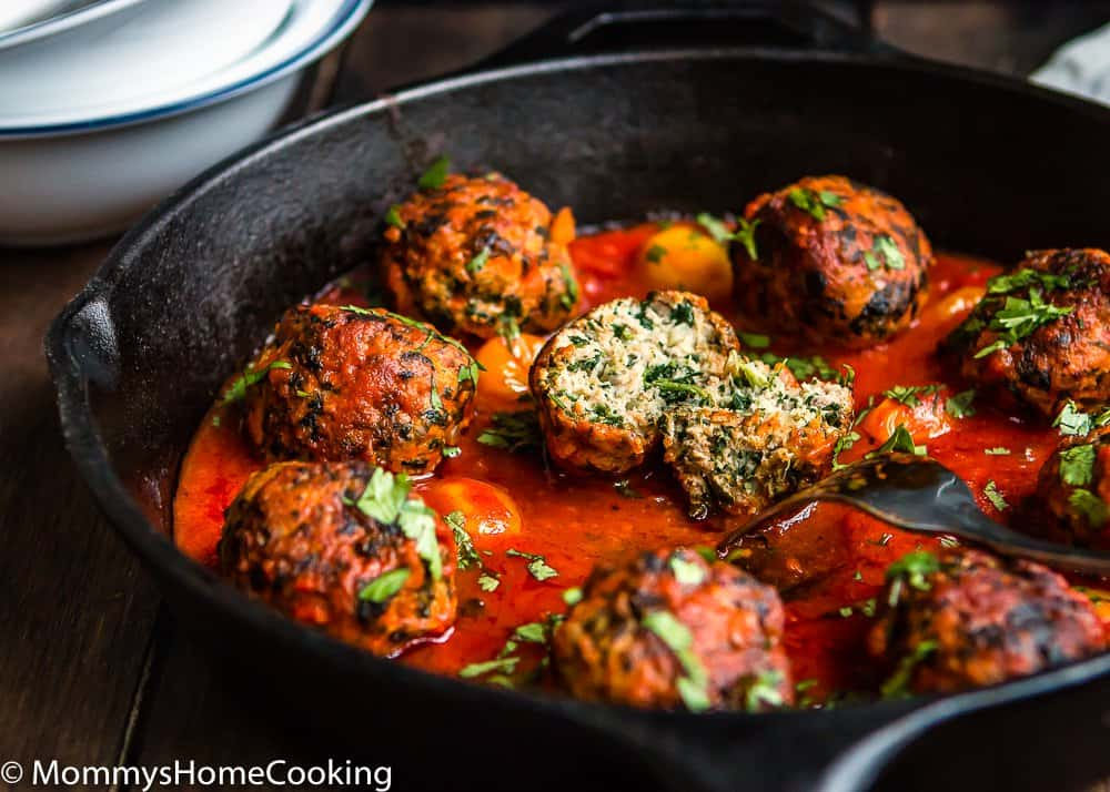 Juicy Eggless turkey meat balls in a cast iron skillet.