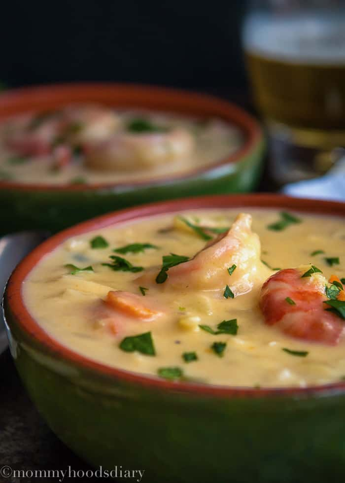 This Three Cheese Shrimp Beer Soup is a delicious and warming way to keep you cozy on chilly days. It's warm, rich and hearty. Ready in less than 30 minutes! https://mommyshomecooking.com