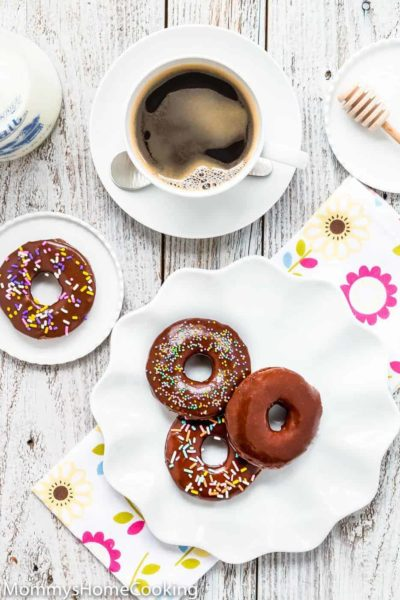 Easy Eggless Chocolate Donuts with chocolate glaze and a cup of coffee