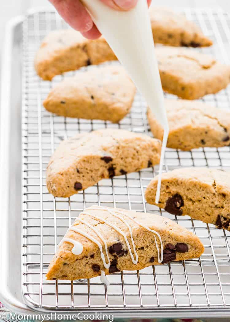 Eggless Chocolate Chip Scone being glazed