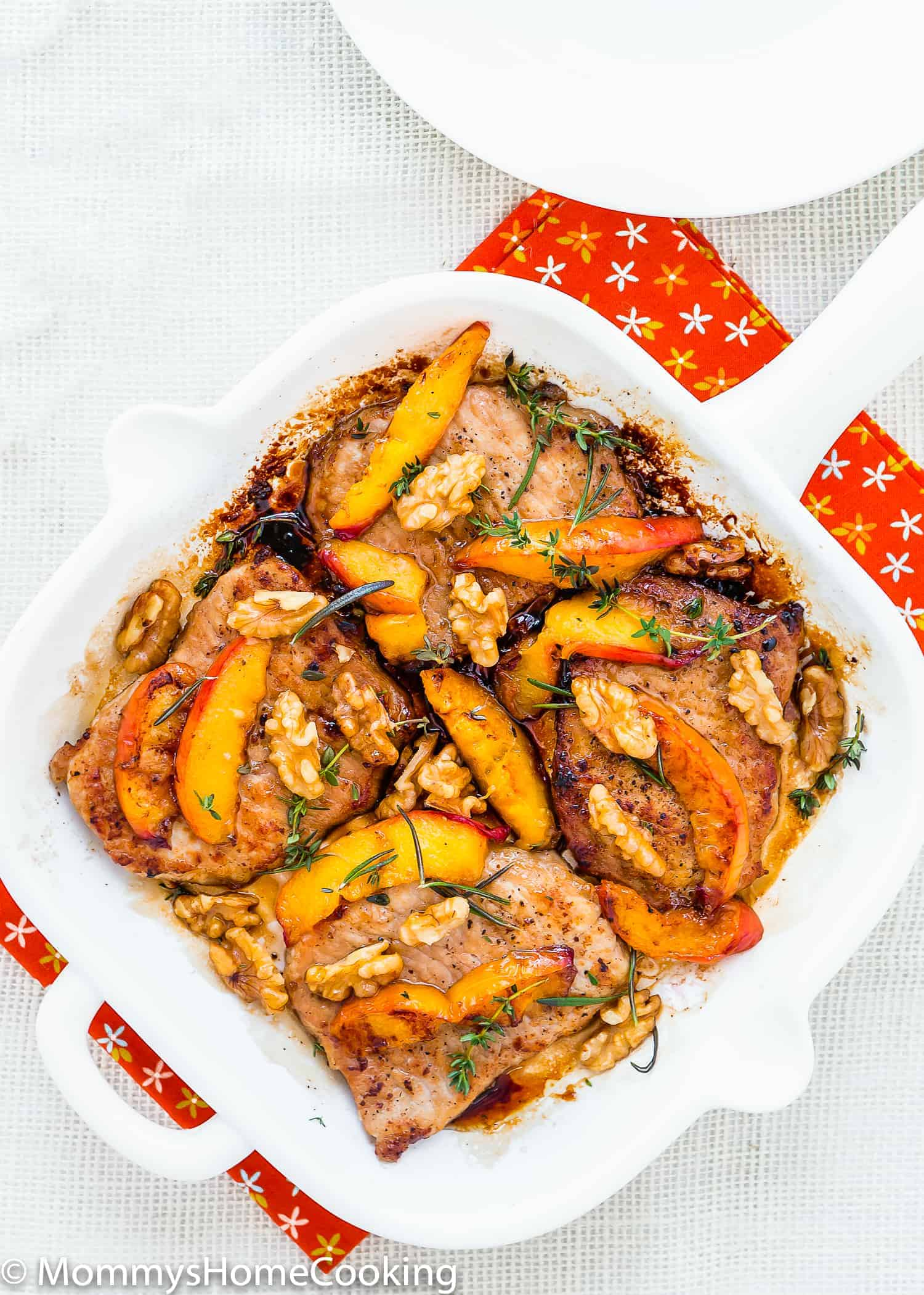 These Grilled Pork Chops with Peaches and Walnuts are the easiest and most amazing pork chops ever…ready in 20 minutes! It doesn't get better than that. Just peachy! http://mommyshomecooking.com