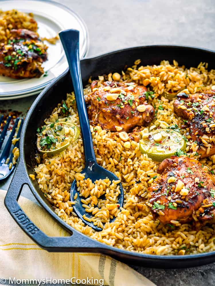 skillet with thai rice and chicken and a serving spoon