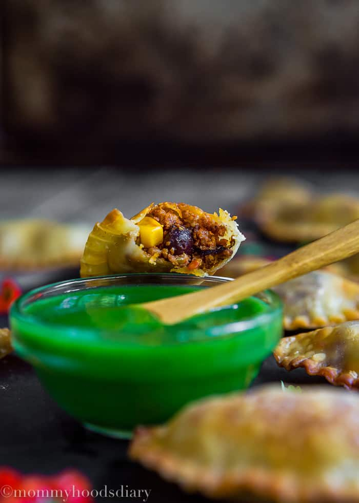 Mini Spicy Pork Chorizo Empanadas bitten