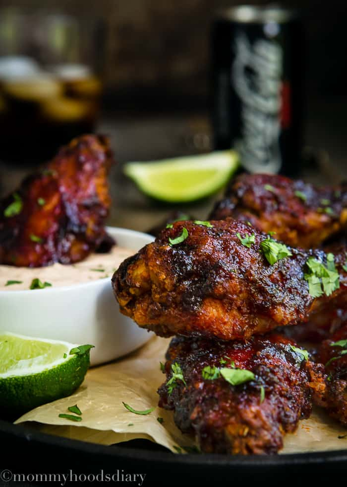 They're sweet. They're spicy. They're finger licking good! These Spicy and Sweet Baked Chipotle Chicken Wings are perfect for entertaining a crowd! https://mommyshomecooking.com