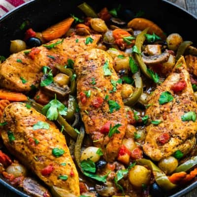Easy Chicken Breasts Cacciatore in a cast iron skillet with veggies