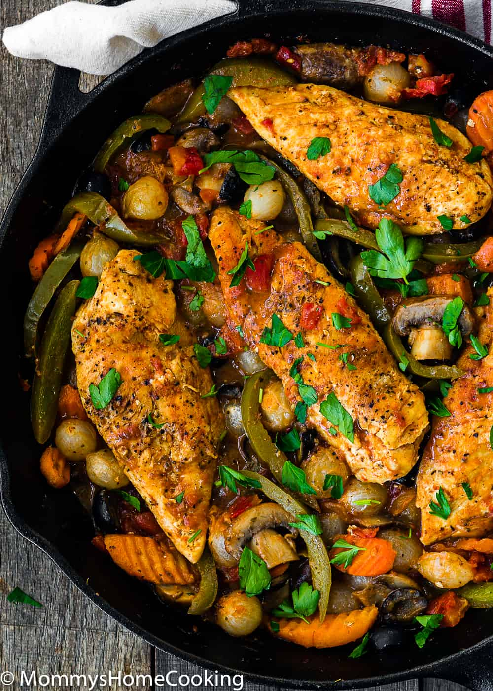 Easy Chicken Cacciatore with veggies  in a cast iron skillet