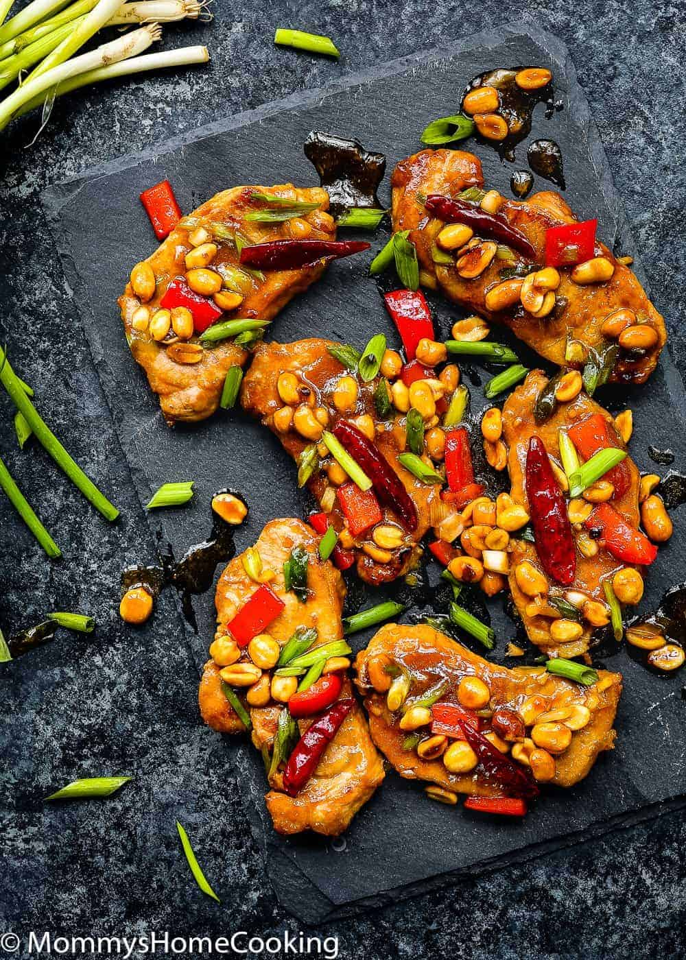 Easy Kung Pao Pork Chops over a black serving plate