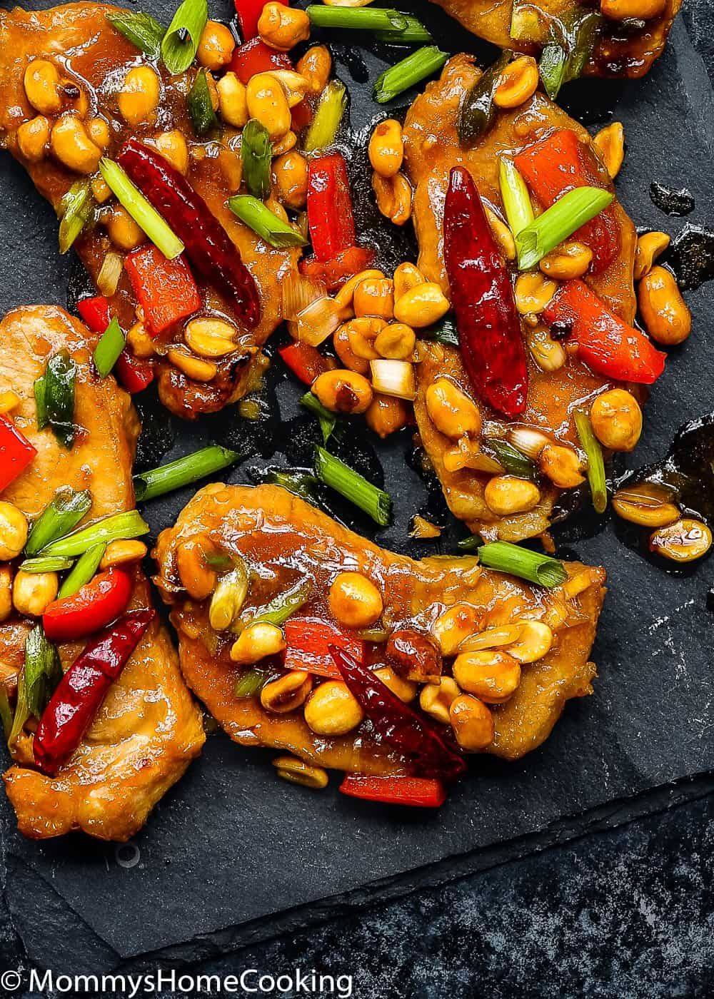 Easy Kung Pao Pork Chops garnished with green onions