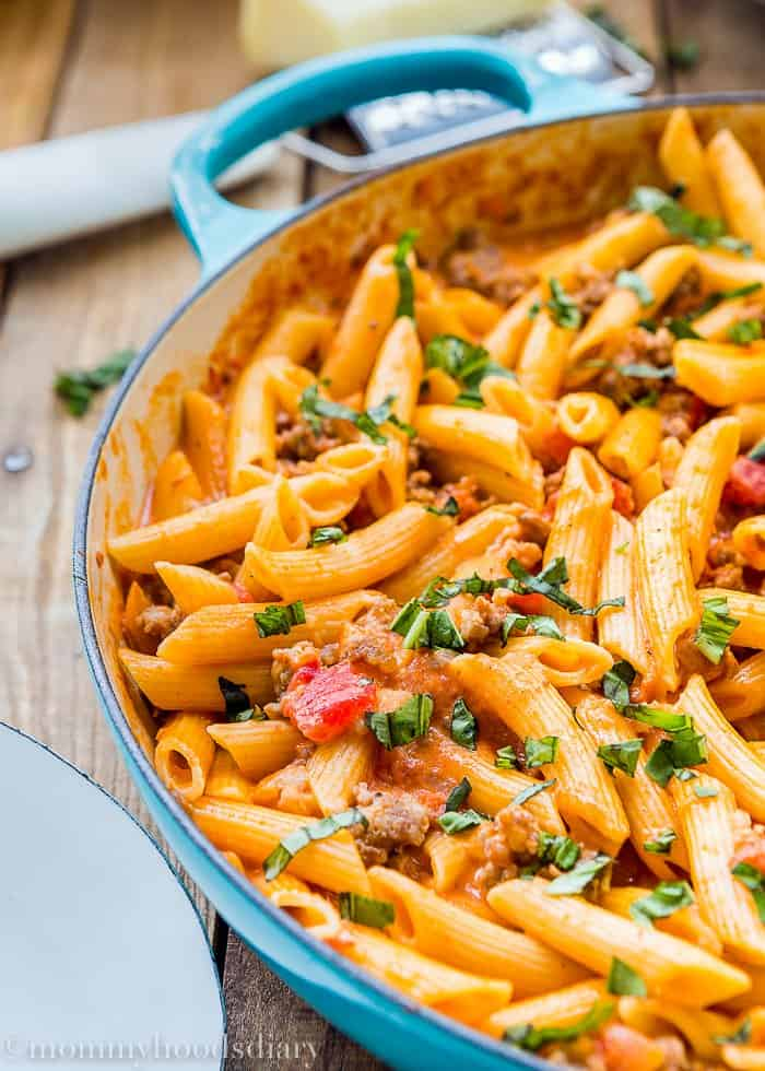 Big skillet with Penne with Sausage and Spicy Cream Tomato Sauce