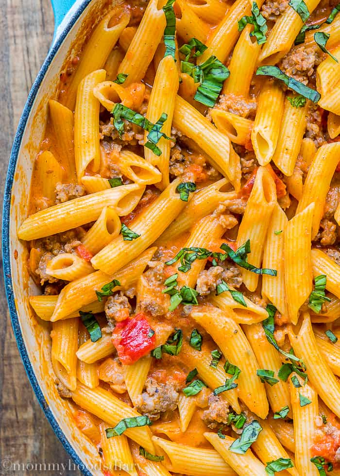 Big skillet with Penne with Sausage and Spicy Cream Tomato Sauce close-up