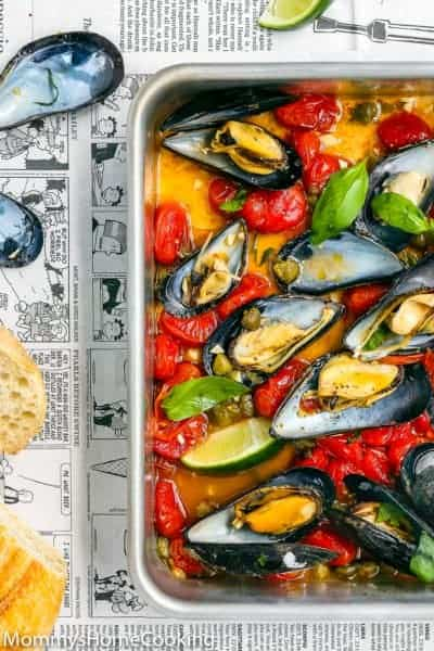 baked mussel with tomatoes, and cappers in a baking pan