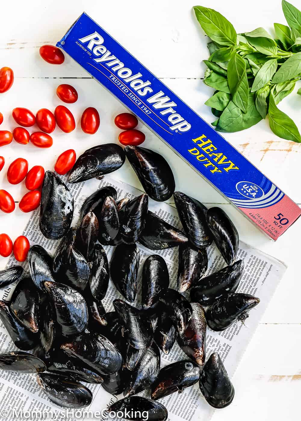 fresh mussels, tomatoes and a roll of foil
