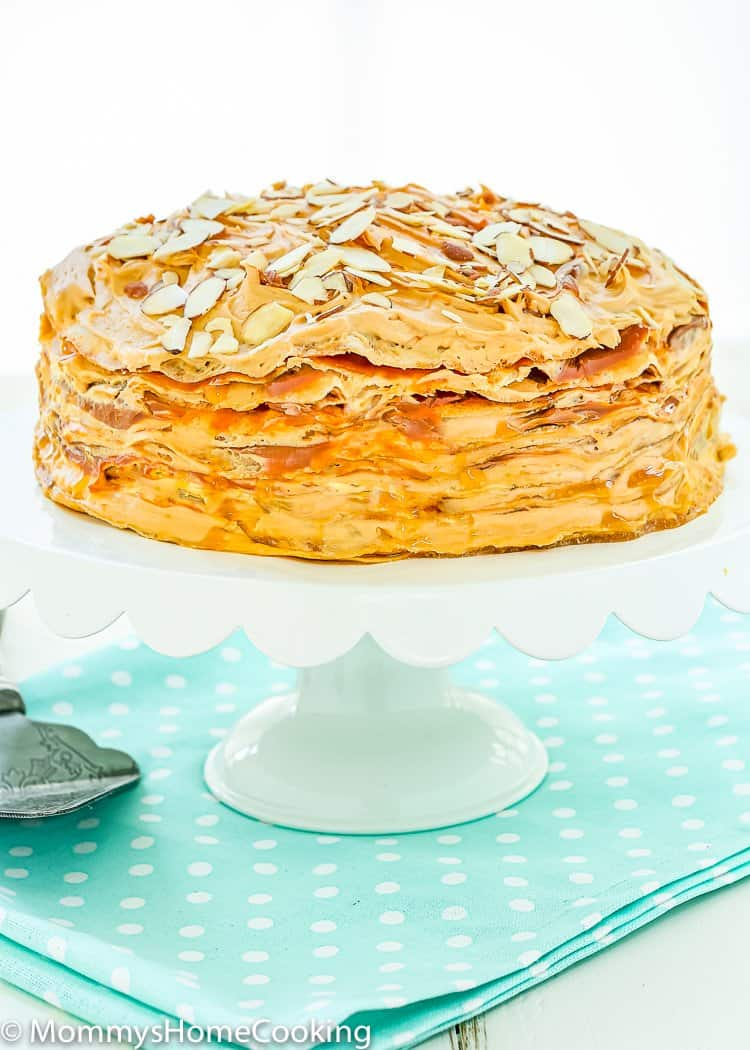 Eggless Dulce de Leche Crepe Cake on a cake stand