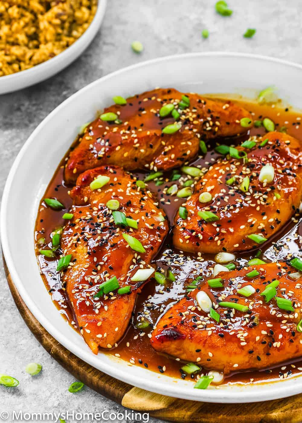 Easy Asian-Style Chicken Breasts in a white skillet
