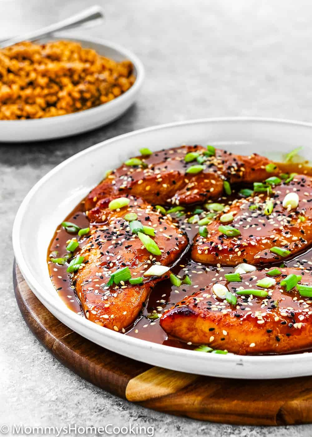 Easy Asian-Style Chicken Breasts in a white skillet with a side of rice