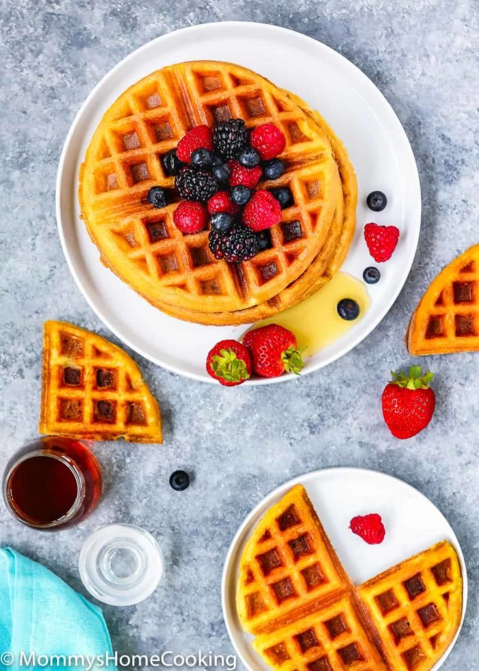This is my staple recipe for golden and buttery Eggless Waffles! They're perfectly crispy on the outside and fluffy on the inside. This recipe has no eggs…and you won't even notice a difference! www.mommyshomecooking.com