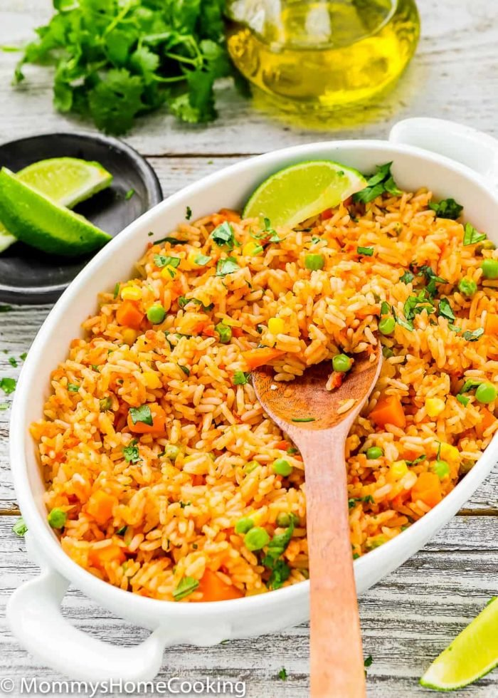 This Easy Mexican Rice is light, fluffy, and flavorful! The best part is that everything gets tossed into the rice cooker, you walk away, and the magic happens in minutes. https://mommyshomecooking.com