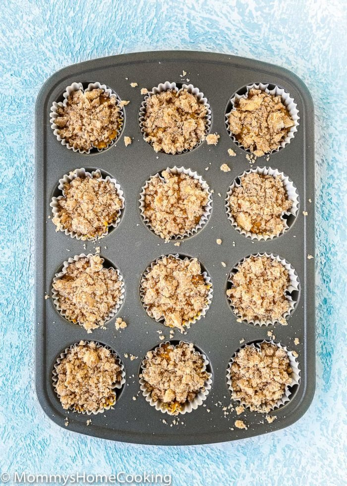 These fail-proof Eggless Pumpkin Muffins are a fantastic crowd-pleasing morning treat! Tender and moist on the inside. Topped with an irresistible crunchy crumb. https://mommyshomecooking.com
