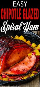 Chipotle Glazed spiral Ham in a cast iron skillet with pineapple and cranberries with descriptive text