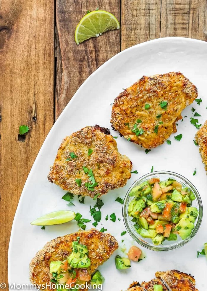 These Low Carb Breadless Skinny Oven Fried Pork Chops are super easy to make and beyond flavorful. It comes together in about 30 minutes, making it a great, and healthy, weeknight dinner. https://mommyshomecooking.com