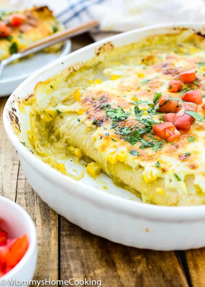 These Chicken and Corn Enchiladas with Creamy Green Sauce are weeknight meal perfection. It's cheesy, it's slightly spicy, it's sensationally delicious. https://mommyshomecooking.com