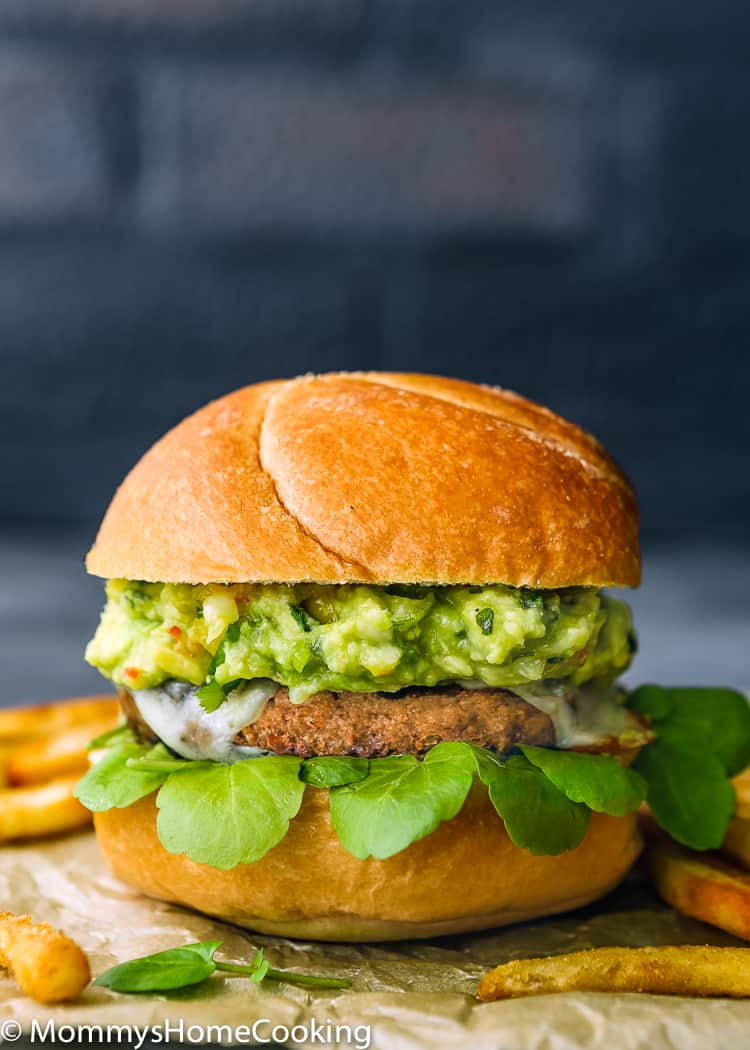 This Mango Guacamole Turkey Burger is a juicy goodness party for your taste buds! It's tasty, smoky, and slathered in THE BEST mango guacamole ever. The perfect, delicious and healthier time-saving alternative to your barbecue spread. https://mommyshomecooking.com