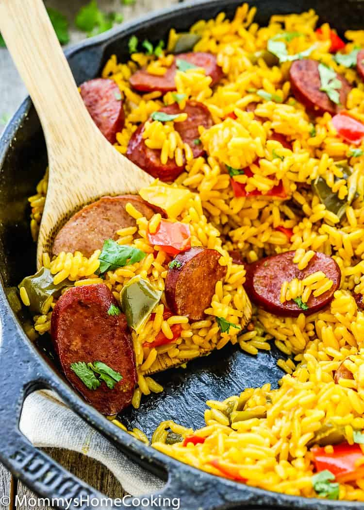 This Easy Sausage and Peppers Rice Skillet is really satisfying and delicious. it's easy and quick to put together since it's done in 30 minutes. Perfect for any day of the week! https://mommyshomecooking.com