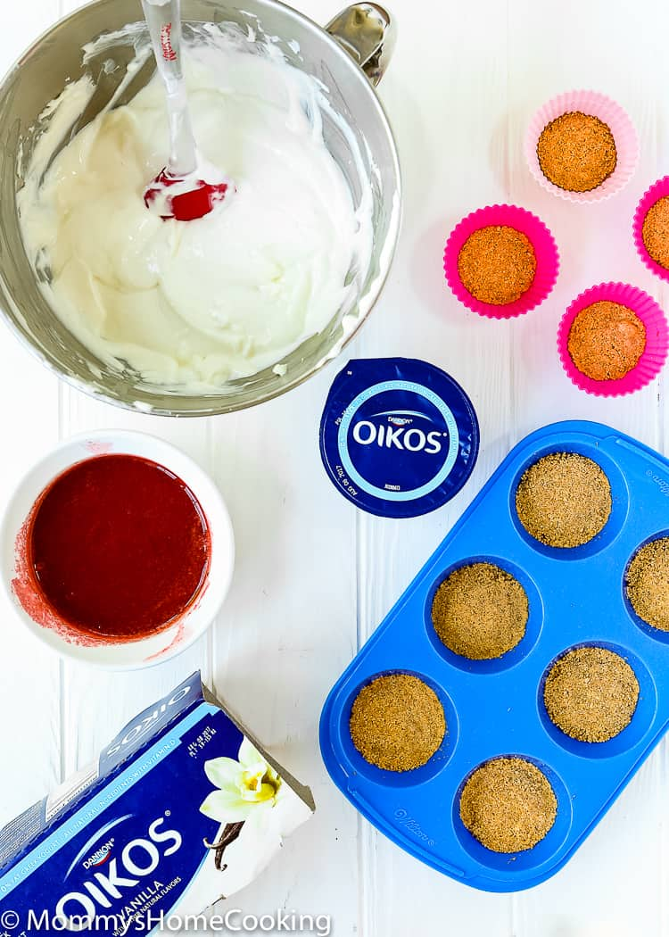 These light and bright Mini Greek Yogurt Strawberry cheesecake are perfect for when it's too hot to turn on the oven. Made with Greek yogurt, these little treats are easy to make and will definitely be a crowd pleaser. https://mommyshomecooking.com