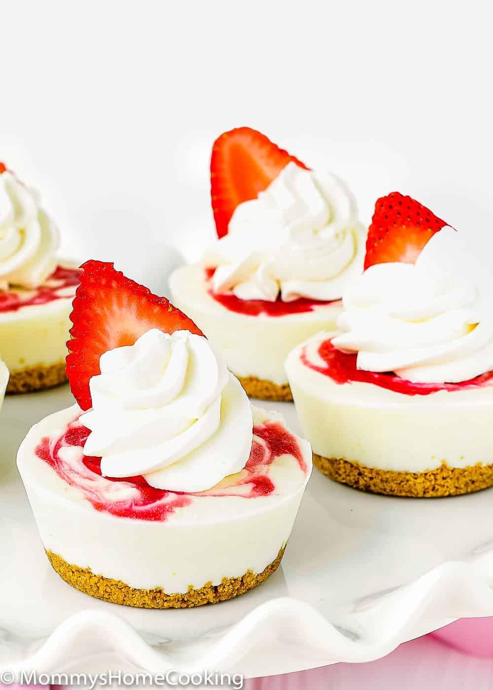 Mini Greek Yogurt Strawberry Cheesecakes with whipped cream