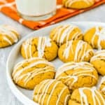 Eggless Pumpkin Cookies on a plate with a glass of milk on the background