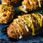 Easy Cheesy Garlic Hasselback Potatoes on a stone serving plate