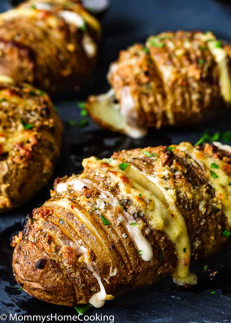 These Easy Cheesy Garlic Hasselback Potatoes are easy to make, so tasty, and would be wonderful with just about any entree. An easy way to impress your family, or guests, is with these pretty baked potatoes. https://mommyshomecooking.com