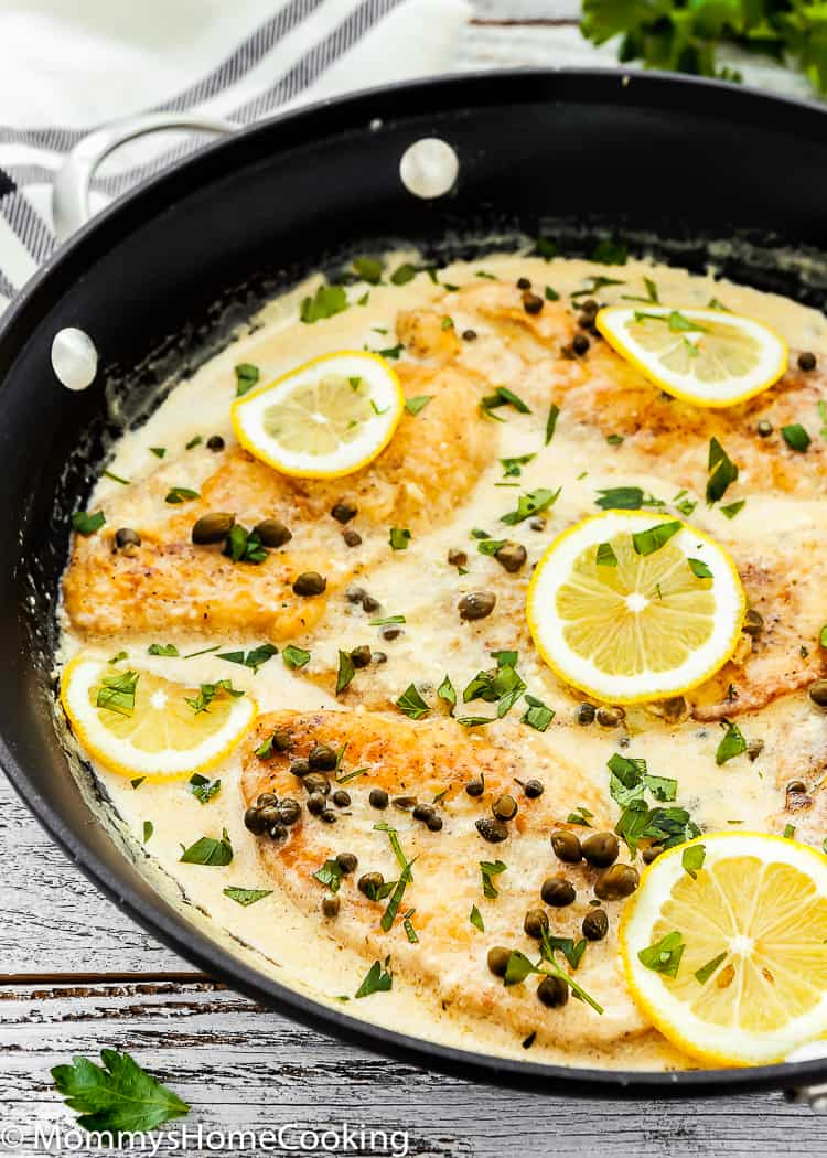 This 30 Minute Easy Chicken Piccata is creamy, citrusy, and full of yummy flavors!!  Perfect weeknight meal. Serve with pasta or mashed potatoes. https://mommyshomecooking.com
